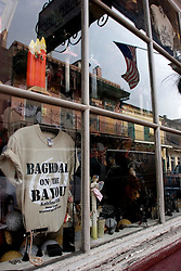 16 December, 2005. New Orleans, Louisiana. Post Katrina aftermath. <br />  A t-shirt in the window of a  Bourbon Street shop in New Orleans says it all. 'Baghdad on the Bayou, Katrina 2005.'<br /> Photo; ©Charlie Varley/varleypix.com