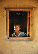 Malawian girl at a window