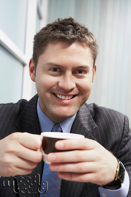 Businessman Holding Coffee Cup portrait head and shoulders