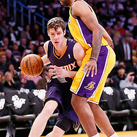 10 December 2013: Phoenix Suns shooting guard Goran Dragic (1) drives past Los Angeles Lakers power forward Shawne Williams (3) during the Phoenix Suns 114-108 victory over the Los Angeles Lakers at the Staples Center, Los Angeles, California, USA.