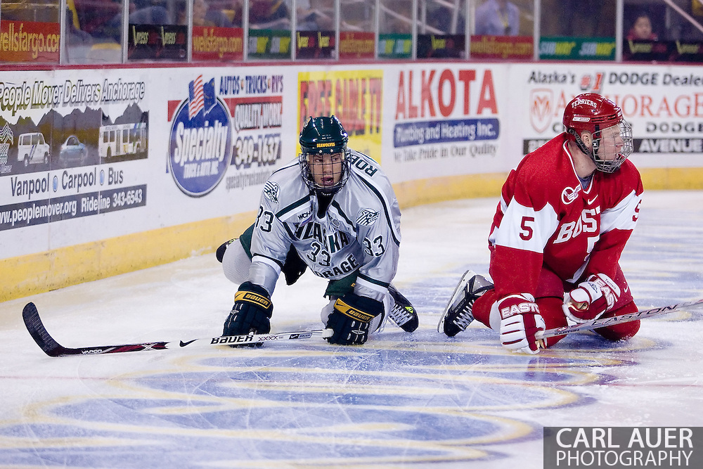 October 13, 2007 - Anchorage, Alaska:  Mat Robinson (33) of the University of Alaska-Anchorage Seawolves and Kevin Kielt (5) of the Boston University Terriers pick them selves up off the ice 4th game of the Nye Frontier Classic at the Sullivan Arena.  UAA and BU would tie 4-4 giving Robert Morris University the title of Nye Frontier Classic Champion.