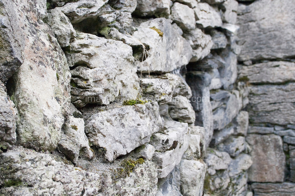 Close up of interior stone walls of Teampall Chaomhan a 10-14th century church ruins on Inis Oirr the Aran Islands Galway Ireland