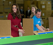 Picture by Mark Larner/Barcroft Media. Picture shows,  Katherine, Duchess of Cambridge, being shown the packing line inside the Copenhagen UNICEF Distribution Depot 02/11/2011...The Duke and Duchess of Cambridge are today visiting children's charity Unicef's emergency supply centre in Copenhagen with with the Crown Prince Frederik and Crown Princess Mary of Denmark.