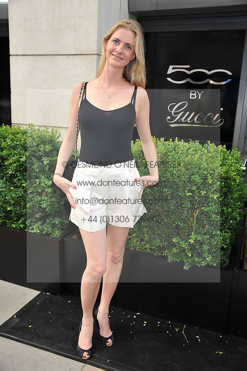 CHLOE DELEVINGNE at a party to launch the Gucci designed Fiat 500 customized by Gucci Creative Director Frida Giannini in collaboration with FIAT's Centro Stile, held at Fiat, 105 Wigmore Street, London on 27th June 2011.