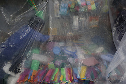 July 24, 2017 - Dhaka, Bangladesh - A street vendor use a plastic sheet to protect his store from rain in Dhaka. A monsoon shower hit the city and disrupted daily life. (Credit Image: © Md. Mehedi Hasan/Pacific Press via ZUMA Wire)
