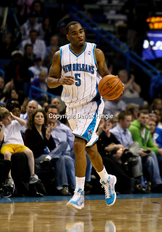 Feb 26, 2010; New Orleans, LA, USA; New Orleans Hornets guard Marcus Thornton (5) drives with the ball during the second half against the Orlando Magic at the New Orleans Arena. The Hornets defeated the Magic 100-93. Mandatory Credit: Derick E. Hingle-US PRESSWIRE