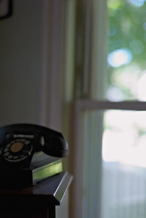 Antique telephone and window light