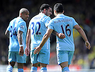 Picture by Andrew Timms/Focus Images Ltd. 07917 236526.14/04/12.Carlos Tevez & Sergio Aguero of Manchester City during the Barclays Premier League match against Norwich City at Carrow Road stadium, Norwich.