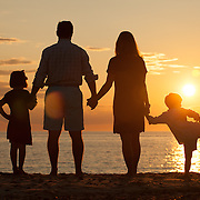 Silhouette of a family and the sunset.