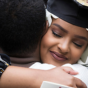 Rakiya Mohamed embraces her brother Mohamed Mohamed, who just graduated from UMA, after following the recessional at the end of Commencement on May 27,2018.