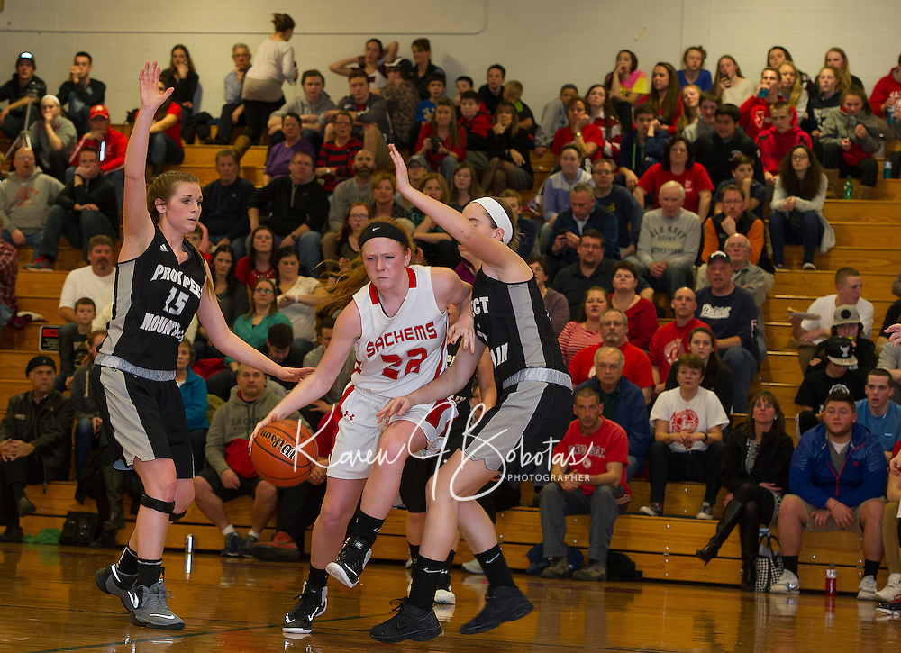 Laconia's Natalie Compton charges through Prospect Mountain's defense Ali Brown and MacKenzie Burke during NHIAA Division III second round tournament action Thursday evening.  (Karen Bobotas/for the Laconia Daily Sun)