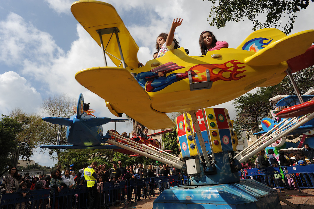 Israeli children are enjoying a crousele during Tel Aviv's main Purim event whuch features the re-creation of Tel Aviv's original zoo which was located where the Gan Ha'ir complex now stands on March 01, 2010.
