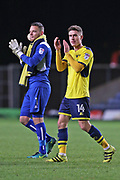 Oxford United Simon Eastwood (1) left and  Oxford United Josh Ruffels (14) centre - applaud the crowd after their 1-0 win today during the EFL Sky Bet League 1 match between Oxford United and Doncaster Rovers at the Kassam Stadium, Oxford, England on 9 December 2017. Photo by Gary Learmonth.