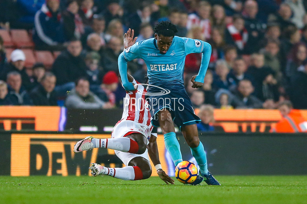 Swansea City  midfielder Leroy Fer (8)  is fouled during the Premier League match between Stoke City and Swansea City at the Britannia Stadium, Stoke-on-Trent, England on 31 October 2016. Photo by Simon Davies.