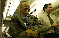 .Secretary of Defense Donald H. Rumsfeld and Acting Assistant Secretary of Defense Public Affairs Lawrence Di Rita talk with the traveling press while in flight prior to arriving to Baku, Azerbaijani on Dec. 03, 2003. Rumsfeld arrived in Baku for talks with President Ilham Aliev and Defense Minister Safar Abiyev.