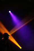 Silhouette of Perquisite during a performance in De Oosterpoort, Groningen.