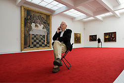 Lothar Meyfarth of Berlin Germany, views paintings by the Flemish masters at the Groeninge Museum in Bruges, Belgium. (Photo © Jock Fistick)