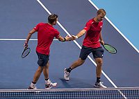 Tennis - 2019 Nitto ATP Finals at The O2 - Day Two<br /> <br /> Doubles Group Max Mirnyi: Kevin Krawietz (GER) & Andreas Mies (GER) Vs. Jean-Julien Rojer (NED) & Horia Tecau (ROM)<br /> <br /> German team mates Kevin Krawietz (GER) and Andreas Mies (GER) congratulate each other after taking the game <br /> <br /> COLORSPORT/DANIEL BEARHAM
