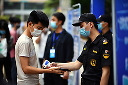 HAIKOU, April 18, 2020  A staff member checks body temperature for a job hunter at a job fair in Haikou, south China's Hainan Province, April 18, 2020. More than 100 enterprises took part in the job fair Saturday, offering 4,000 job opportunities. (Credit Image: © Guo Cheng/Xinhua via ZUMA Wire)