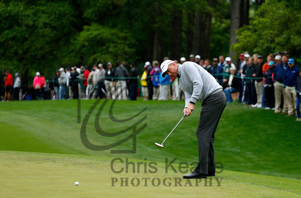 Robert Karlsson of Sweden watches his putt on the fourth hole during the final round of the Wells Fargo Championship at the Quail Hollow Club in Charlotte, North Carolina on May 5, 2013.  (Photo by Chris Keane - www.chriskeane.com)