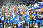 Champions Wigan lift the trophy after the Sky Bet League 1 match between Wigan Athletic and Barnsley at the DW Stadium, Wigan, England on 8 May 2016. Photo by John Marfleet.