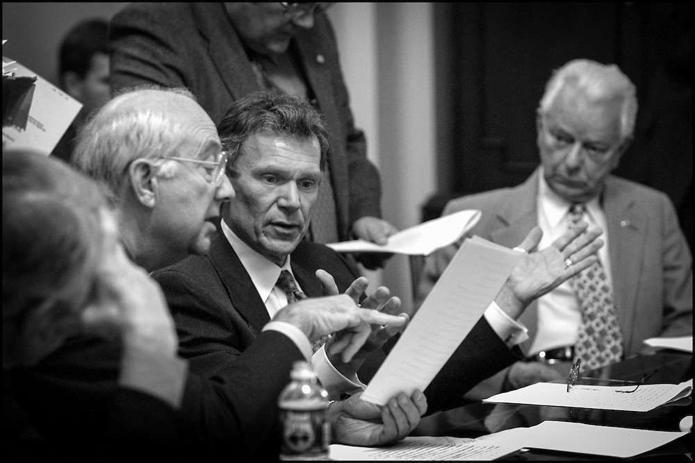 Phil Gramm and Tom Daschle confer over the wording of the appropriations bill for Bush concerning the terrorist acts. 9/13/01..©PF BENTLEY/PFPIX.com