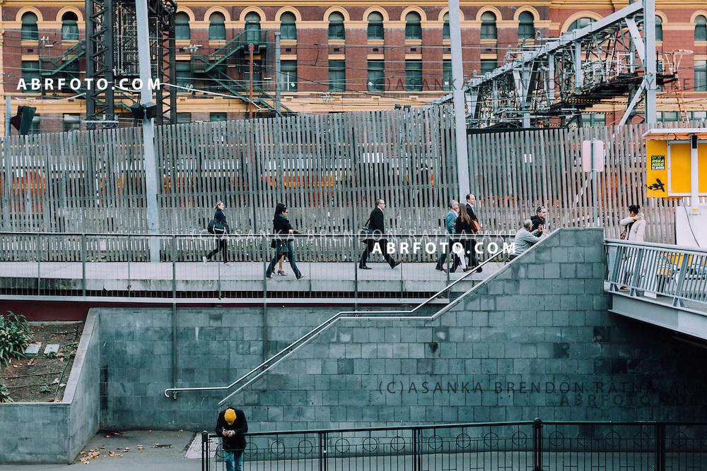 Commuters outside of Flinders street station Melbourne Victoria Australia
