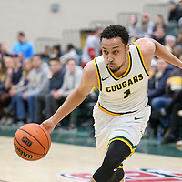5th year guard Aaron McGowan (1) of the Regina Cougars in action during the home game on December  2 at Centre for Kinesiology, Health and Sport. Credit: Arthur Ward/Arthur Images