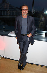Fashion designer JACQUES AZAGURY at a party to celebrate the UK launch of Diana:The Portrait, the authorised book about the late Princess Of Wales's life and work, held at the National Portrait Gallery, London on 1st September 2004.  The book was commissioned by The Diana, Princess of Wales Memorial Fund and writen by Ros Coward.