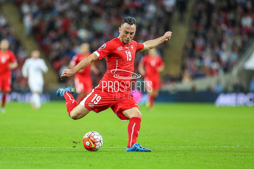 Switzerland's Josip Drmic takes a shot during the UEFA European 2016 Qualifying match between England and Switzerland at Wembley Stadium, London, England on 8 September 2015. Photo by Shane Healey.