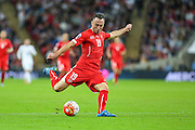 Switzerland's Josip Drmic takes a shot during the UEFA European 2016 Qualifying match between England and Switzerland at Wembley Stadium, London, England on 8 September 2015. Photo by Shane Healey.