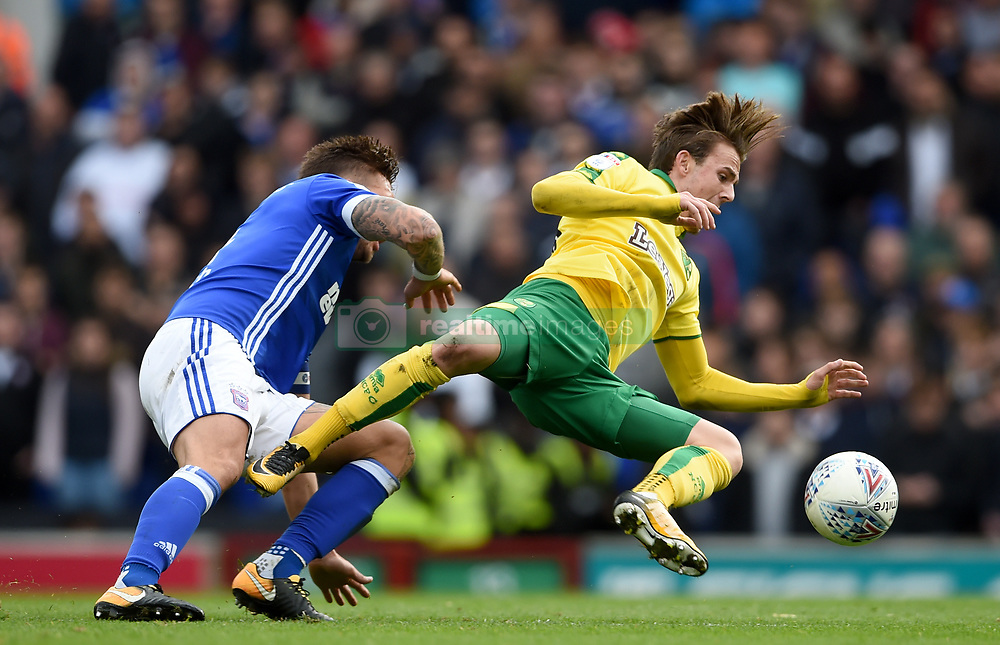 Ipswich Town's Luke Chambers (left) and Norwich City's James Maddison battle for the ball during the Skybet Championship match at Portman Road, Ipswich.