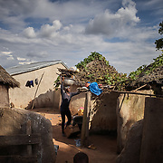 30/10/2019 Tambalug / Ghana: <br /> Elizabeth returns from the farm with firewood.<br /> <br /> For the past five years, Oxfam has been absent in Kpatia and Tambalug (2 communities in Garu Tempane District of the Upper East Region of Ghana).  This project is a visual documentary study on the impact of climate change on these farming communities, in the absence of fresh aid.