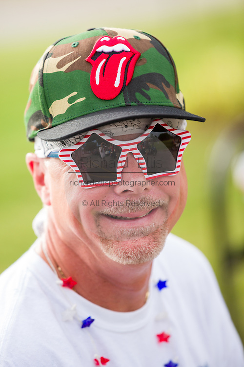 A man wears silly patriotic sunglasses during the Daniel Island Independence Day parade July 3, 2015 in Charleston, South Carolina.