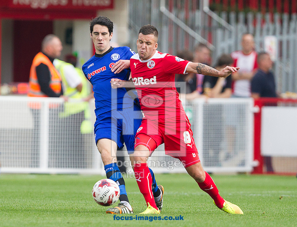 Jimmy Smith of Crawley Town and Peter Vincenti of Rochdale challenge for the ball during the Sky Bet League 1 match at Broadfield Stadium, Crawley<br /> Picture by Paul Terry/Focus Images Ltd +44 7545 642257<br /> 06/09/2014