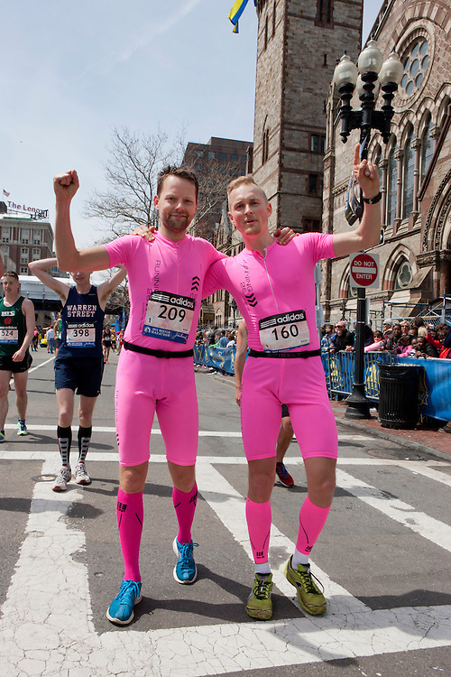 2013 Boston Marathon: two matching male runners dressed in tight hot pink attire