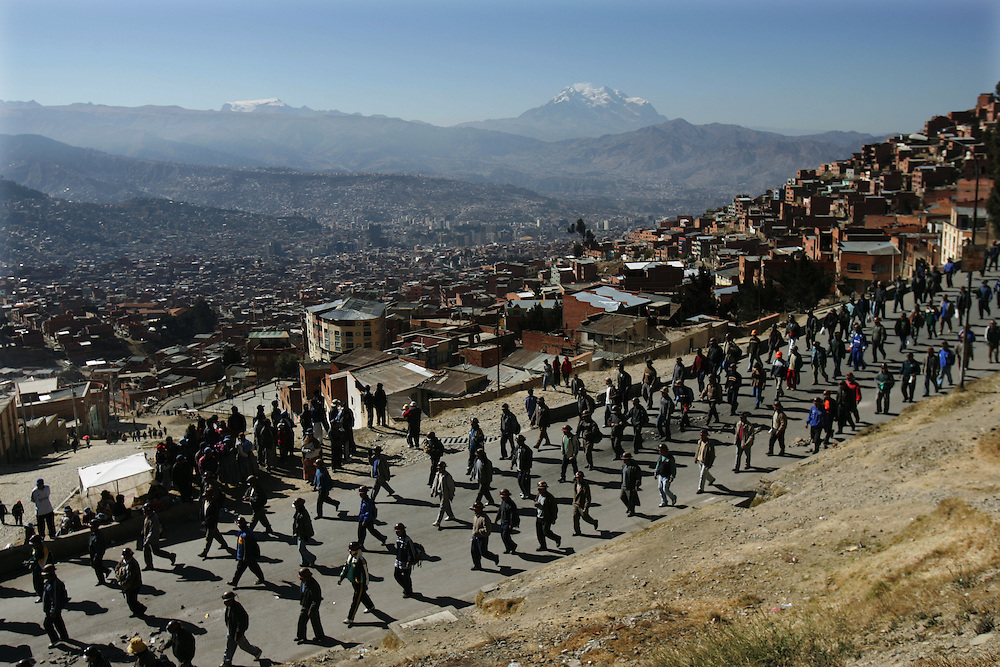 A group marches in protest from the hills of El Alto down into the capital of La Paz, Bolivia. Three weeks of protests that have rocked Bolivia led to President Mesa offering his resignation, for the second time this year, to congress. Blockades, protests and concentrations have brought the country to a standstill and confrontations between police and protestors happen daily.  At the center of the conflict is the indigenous movement's desire to nationalize gas and rewrite the constitution. Congress must now meet to decide of they will accept the president's resignation.