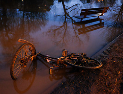 © Licensed to London News Pictures. 29/12/15<br /> York, UK. <br /> <br /> A bicycle lies in the mud as flood water begins to subside on Huntington Road in York. Further rainfall is expected over coming days as Storm Frank approaches the east coast of the country.<br /> <br /> Photo credit : Ian Forsyth/LNP