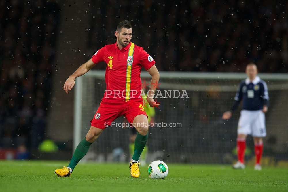 GLASGOW, SCOTLAND - Friday, March 22, 2013: Wales' Joe Ledley in action against Scotland during the 2014 FIFA World Cup Brazil Qualifying Group A match at Hampden Park. (Pic by David Rawcliffe/Propaganda)