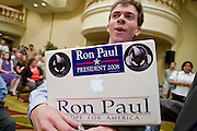 """May 22, 2008 - Phoenix, AZ: THAD GETTERMAN, from Tucson, AZ, carries an Apple iBook while blogging about a Ron Paul campaign rally in Phoenix Thursday. About 850 people crowded into the ballroom at the Pointe Hilton Squaw Peak Resort in Phoenix, AZ, to hear Republican presidential hopeful Ron Paul speak. Although Arizona Sen. John McCain is the """"presumptive"""" Republican candidate for president, Texas Congressman Ron Paul is staying in the race and actively campaigning for the Presidency. Photo by Jack Kurtz"""