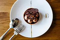 A chocolate tart with brownie and candied nuts at Maison Marou Cafe in Ho Chi Minh City, Vietnam.
