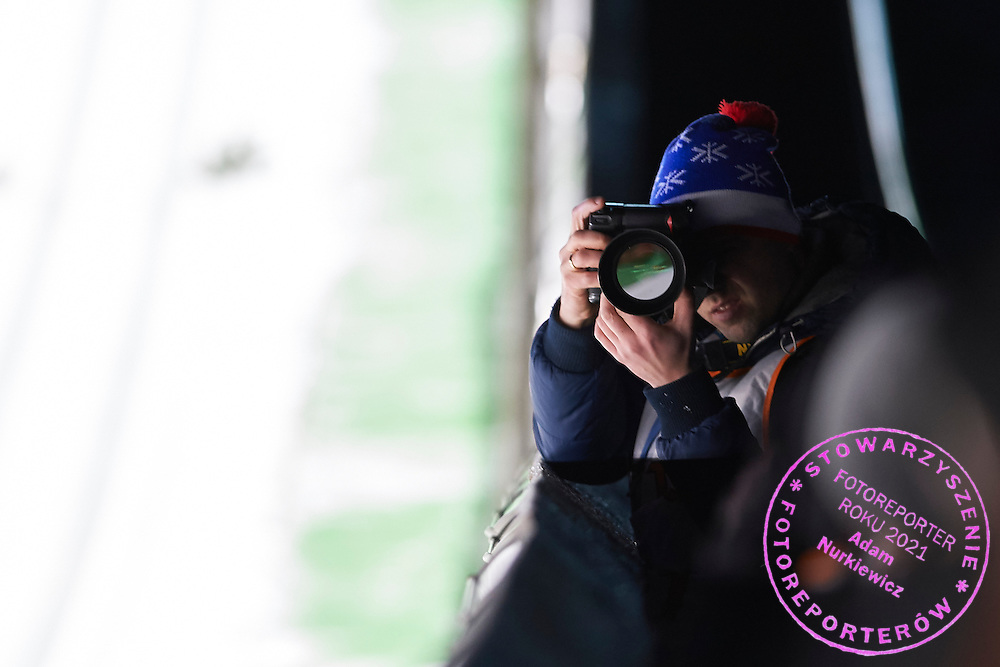 Photographer shoots pictures during FIS World Cup Ski Jumping competition in Wisla, Poland on January 15, 2015.<br /> <br /> Poland, Wisla, January 15, 2015.<br /> <br /> Picture also available in RAW (NEF) or TIFF format on special request.<br /> <br /> For editorial use only. Any commercial or promotional use requires permission.<br /> <br /> Mandatory credit:<br /> Photo by &copy; Adam Nurkiewicz / Mediasport