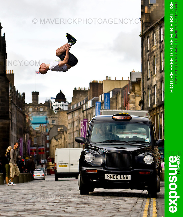 """Pic Free For Use For First Use Only..Stefan Brown leaps over a taxi on Edinburg's Royal Mile to launch the new """"Urbathon"""" event to be held in Scotlands capital...HUNDREDS of runners will have the chance to jump, climb and crawl their way through the capital in the first  10 kilometre race of its kind to take place in Scotland which involves obstacle course challenges. ..Picture Michael Hughes/Maverick Exposure 2/8/09..Contact Jen Smith @ Chest Heart and Stroke Scotland for more details Tel. 07824997100."""