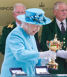 The Queen presents the Gold Cup at Royal Ascot. Image ©Licensed to i-Images Picture Agency. 19/06/2014. Ascot, United Kingdom. Royal Ascot. Ascot Racecourse. Picture by i-Images