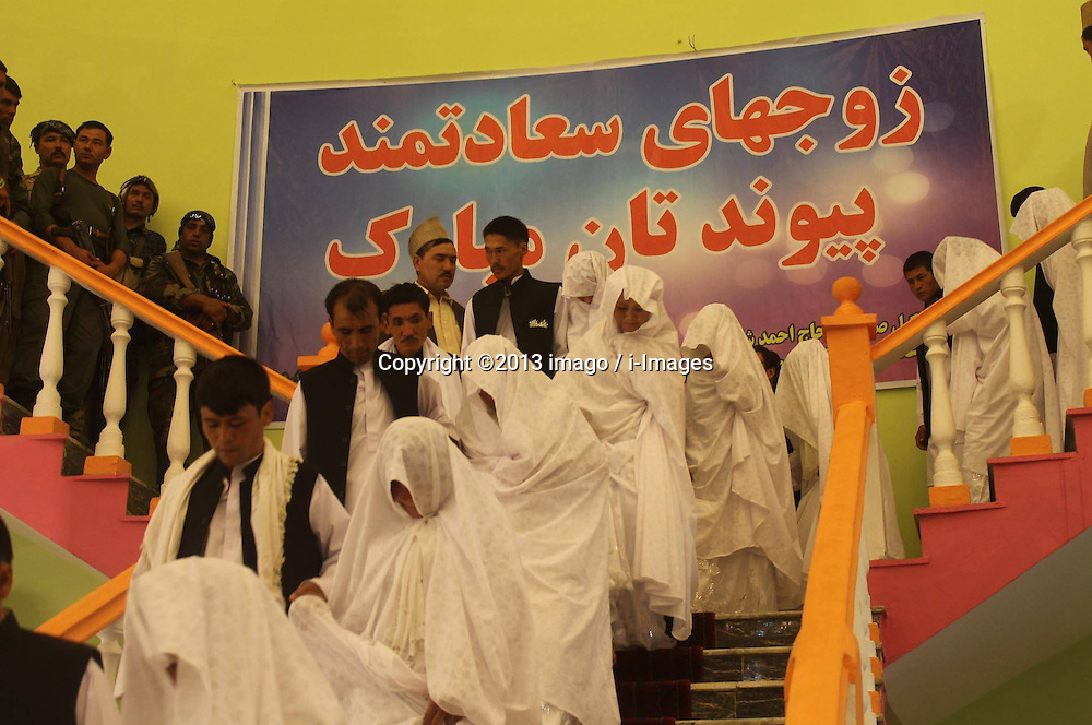 60354094<br /> Couples attend a mass charity wedding ceremony in Balkh province, northern Afghanistan, on August 13, 2013. Charities organised the mass wedding for some 52 couples to help who are unable to afford individual ceremonies.<br /> Balkh province, northern Afghanistan, Wednesday August 13, 2013.<br /> Picture by imago / i-Images<br /> UK ONLY