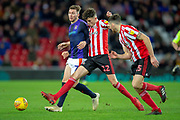 Tom Flanagan (#12) of Sunderland AFC tackles Jack Stacey (#7) of Luton Town FC during the EFL Sky Bet League 1 match between Sunderland AFC and Luton Town at the Stadium Of Light, Sunderland, England on 12 January 2019.