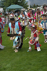 WY: Wyoming, Cody: Dancing at Plains Indian June Powwow...Photo #: yellow562.Photo copyright Lee Foster, 510/549-2202, lee@fostertravel.com, www.fostertravel.com..