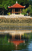 A beautiful Balinese Bale or Pavilion reflected in the water in Bali, Indonesia.