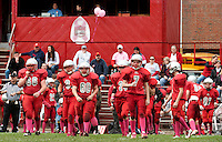 """Members of the Laconia Sachems Middle School football team take to the field wearing """"pink socks"""" Saturday morning in dedication and to raise funds and awareness for Breast Cancer Research.  (Karen Bobotas/for the Laconia Daily Sun)"""