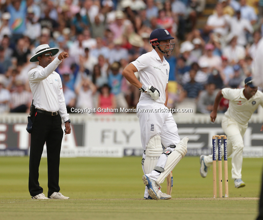 Captain Alastair Cook watches as Sam Robson is out to Ravindra Jadeja during the second Investec Test Match between England and India at Lord's Cricket Ground, London. Photo: Graham Morris/www.cricketpix.com (Tel: +44 (0)20 8969 4192; Email: graham@cricketpix.com) 20/07/14